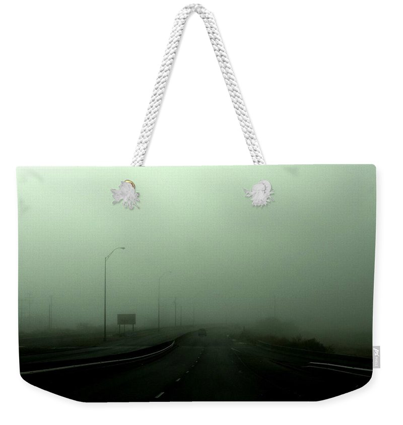 Smog Weekender Tote Bag featuring the photograph Lost by M Pace