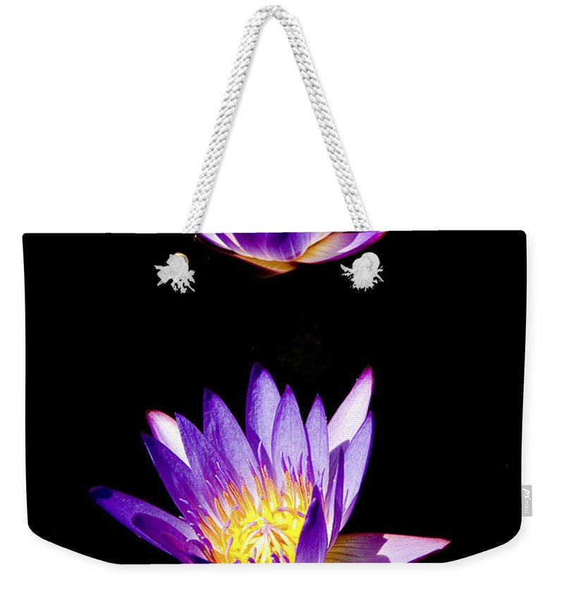 Lotus Weekender Tote Bag featuring the photograph Lotus Flowers by Peter Lloyd
