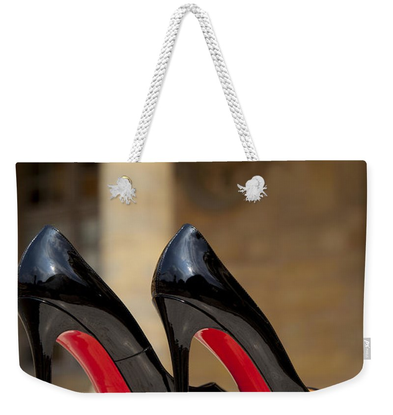 Black Weekender Tote Bag featuring the photograph Louboutin Heels by Brian Jannsen
