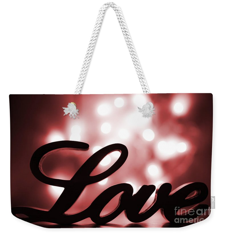 Love Weekender Tote Bag featuring the photograph Love Sign With Red Sparkle by Simon Bratt Photography LRPS
