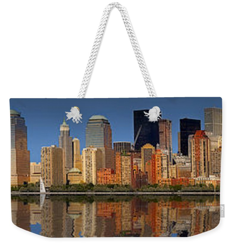 America Weekender Tote Bag featuring the photograph Lower Manhattan Skyline by Susan Candelario