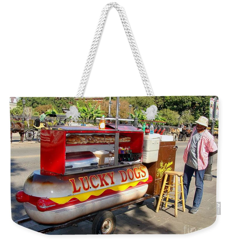 New Orleans Weekender Tote Bag featuring the photograph Lucky Dogs by Ed Weidman
