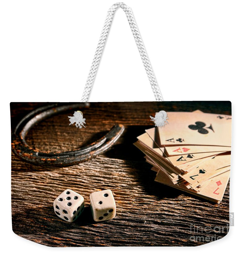 Craps Weekender Tote Bag featuring the photograph Lucky by Olivier Le Queinec