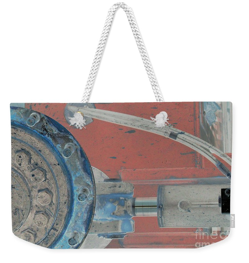 Equipment Weekender Tote Bag featuring the photograph Lug Nut Wheel Left by Heather Kirk