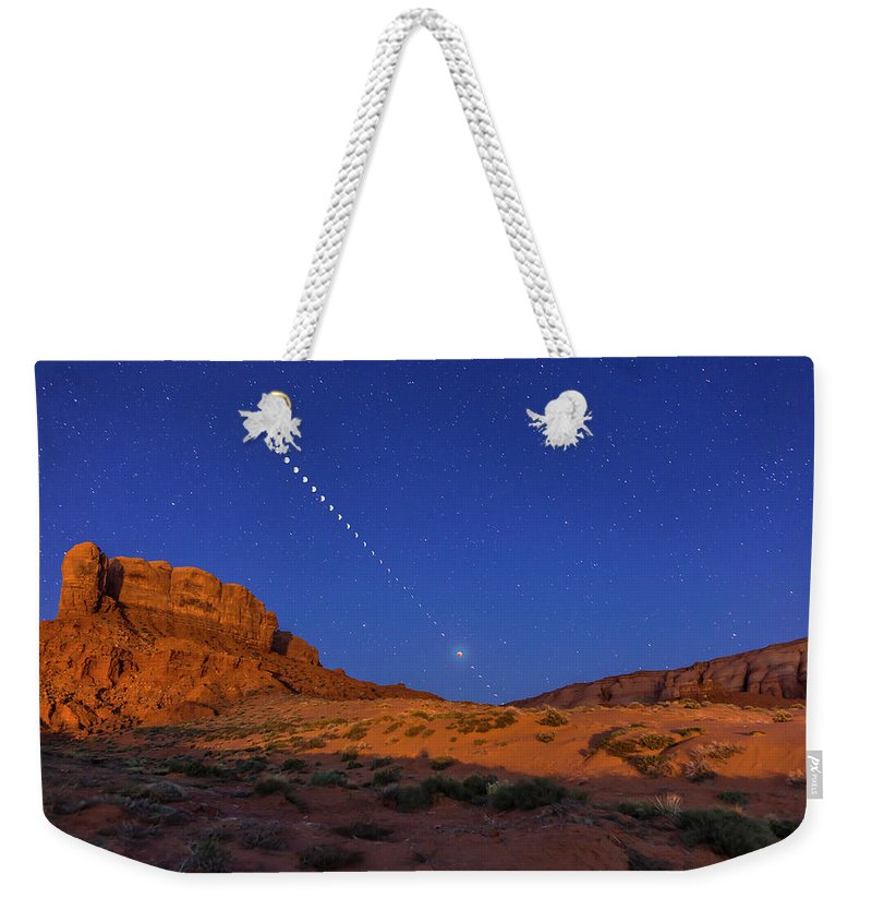 2015 Weekender Tote Bag featuring the photograph Lunar Eclipse Sequence From Monument by Alan Dyer