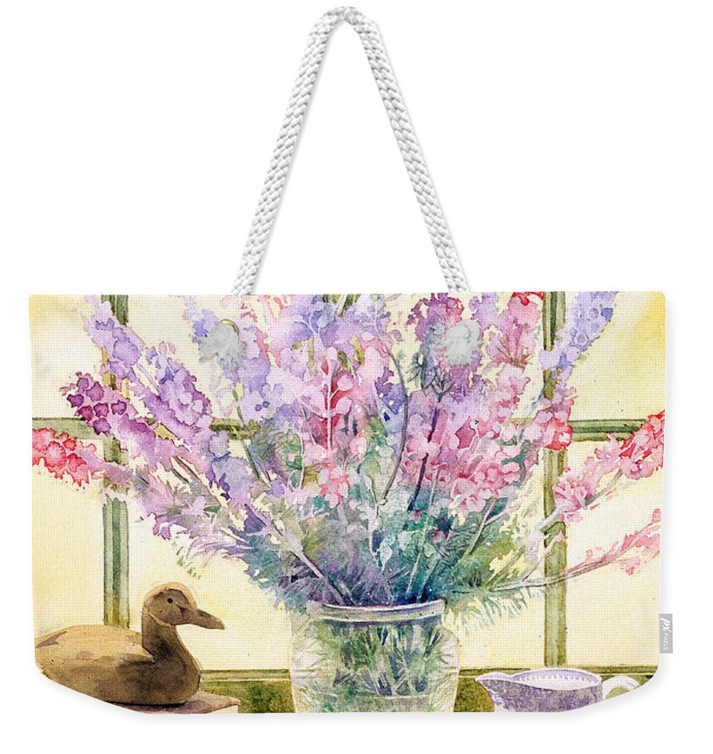 Book Weekender Tote Bag featuring the photograph Lupins On Windowsill by Julia Rowntree