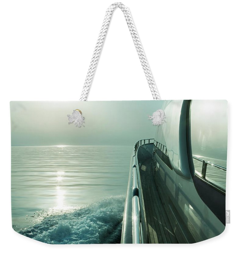 Desaturated Weekender Tote Bag featuring the photograph Luxury Motor Yacht Sailing At Sunset by Petreplesea