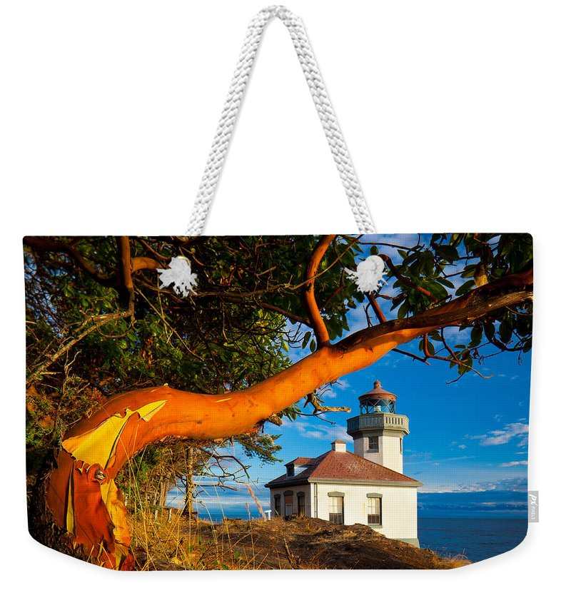 America Weekender Tote Bag featuring the photograph Madrone And Lighthouse by Inge Johnsson