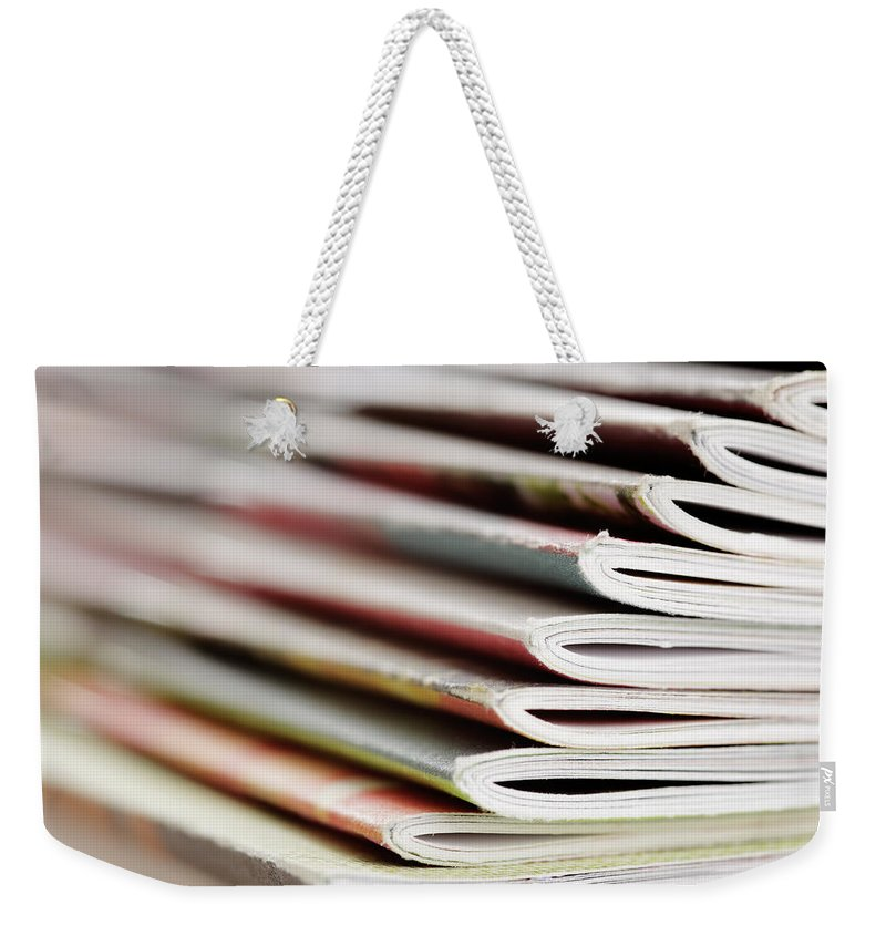 Information Medium Weekender Tote Bag featuring the photograph Magazines by Temmuzcan