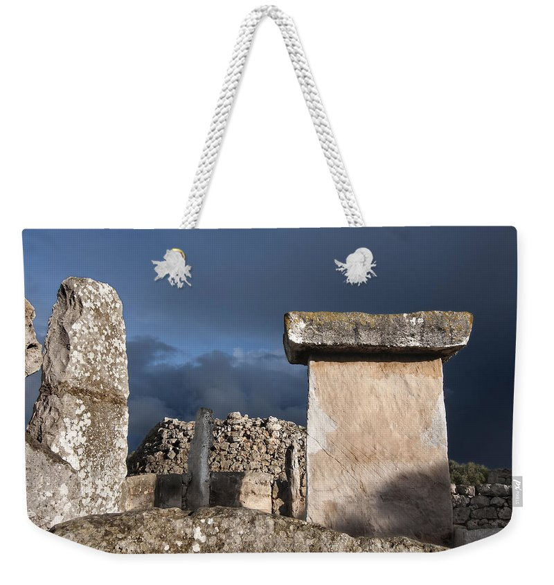 Ancient Weekender Tote Bag featuring the photograph Bronze Edge In Minorca Called Talaiotic Age Unique At World - Magic Island 1 by Pedro Cardona Llambias