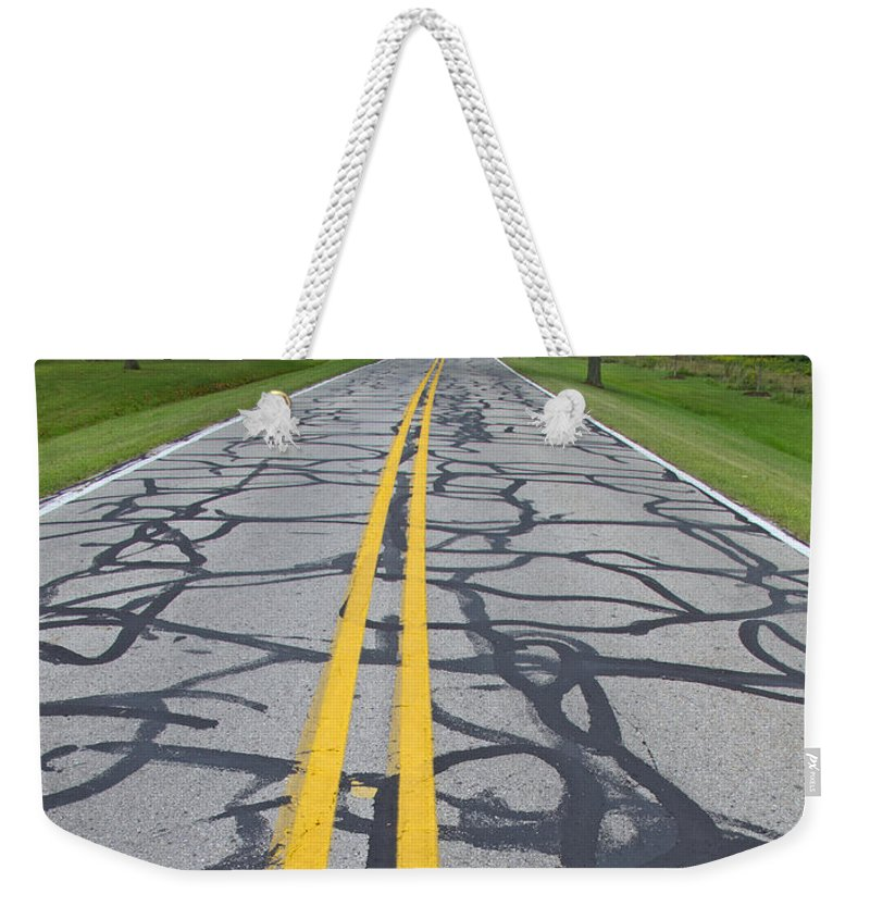 Road Weekender Tote Bag featuring the photograph Making Do On A Tight Budget by Ann Horn