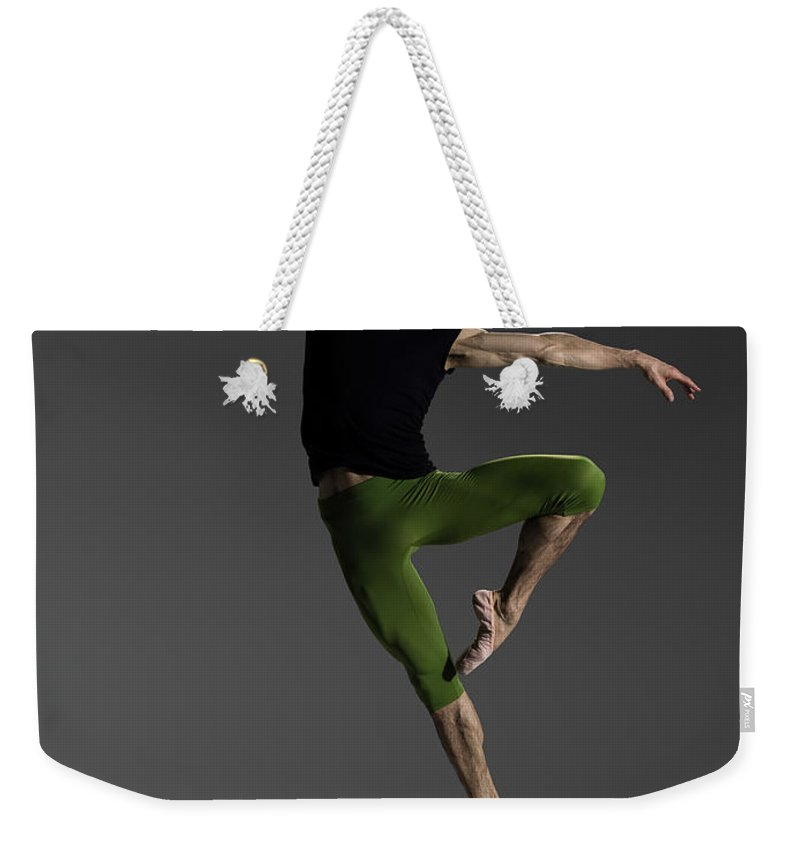 Ballet Dancer Weekender Tote Bag featuring the photograph Male Ballet Dancer Jumping In Passé by Nisian Hughes