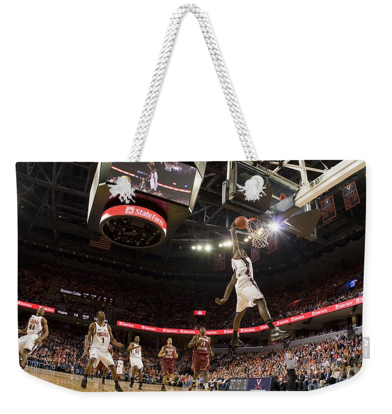 Athletics Weekender Tote Bag featuring the photograph Mamadi Diane Dunk Against Boston College by Jason O Watson