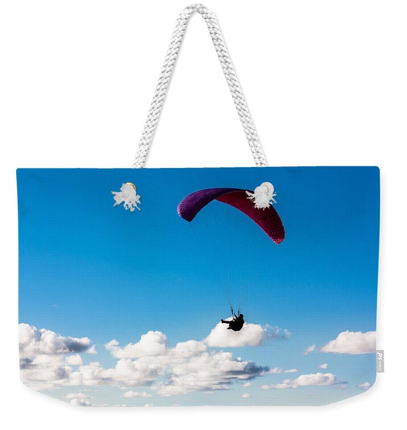 Man Bird Weekender Tote Bag featuring the photograph Man Bird by Edgar Laureano