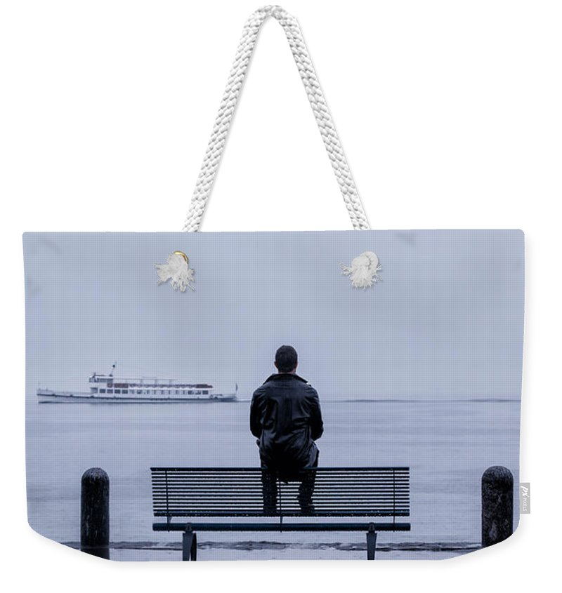 Male Weekender Tote Bag featuring the photograph Man On Bench by Joana Kruse