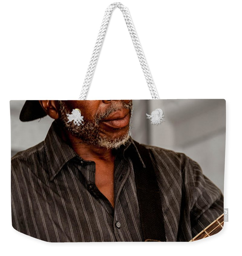 Guitar Weekender Tote Bag featuring the photograph Man On Guitar by Jon Cody