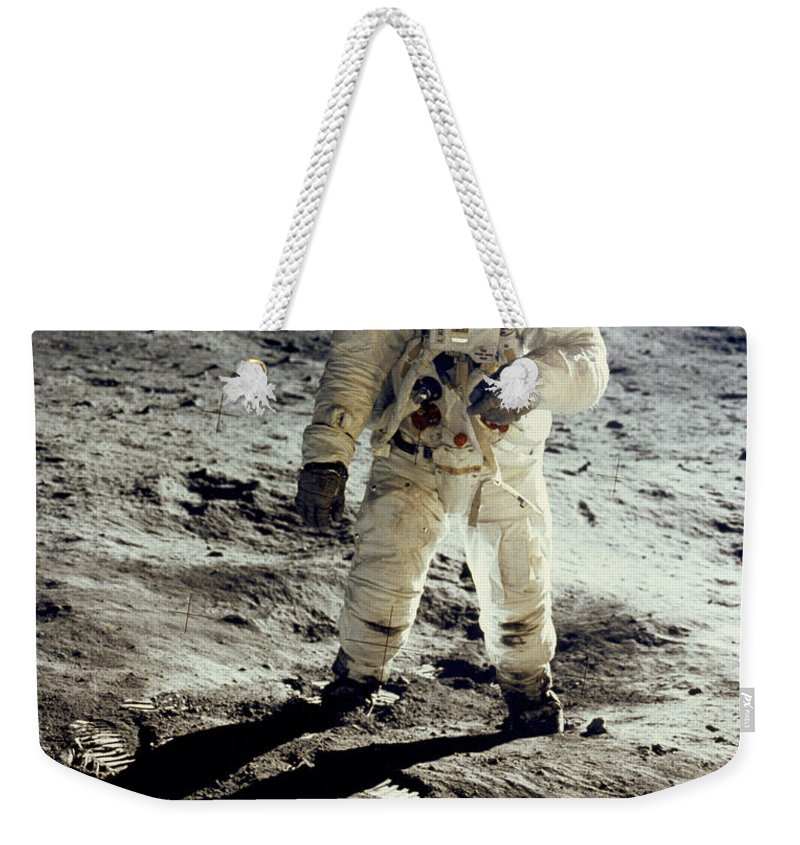 1 Person Weekender Tote Bag featuring the photograph Man On The Moon by Neil Armstrong/Underwood Archive