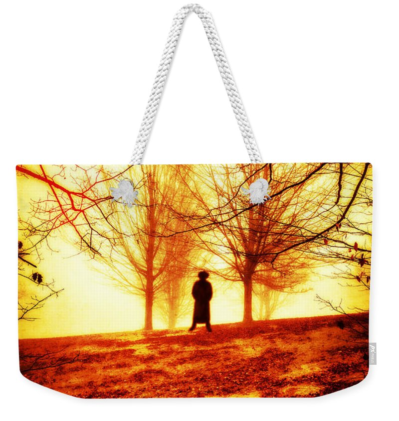 Hell Weekender Tote Bag featuring the photograph Man Standing In Front Of A Blazing Forest Fire by Edward Fielding