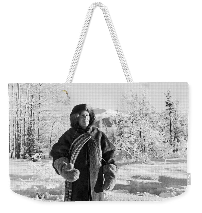 1920s Weekender Tote Bag featuring the photograph Man With Parka And Snowshoes by Underwood Archives