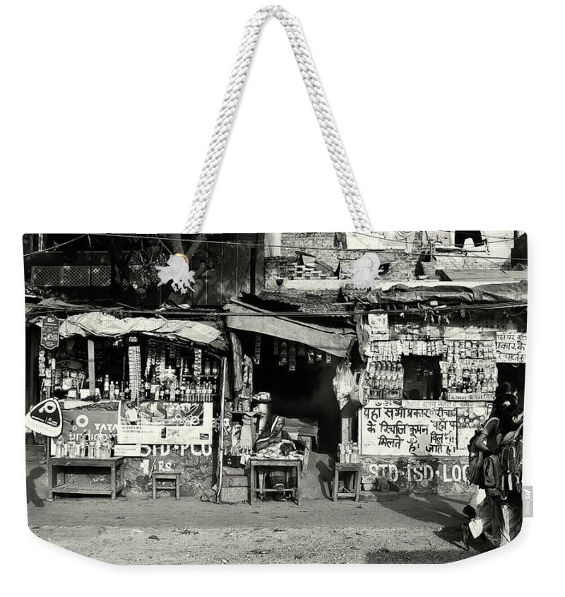 Travel Weekender Tote Bag featuring the photograph Man Woman And Schoolgirls by Roberto Pagani