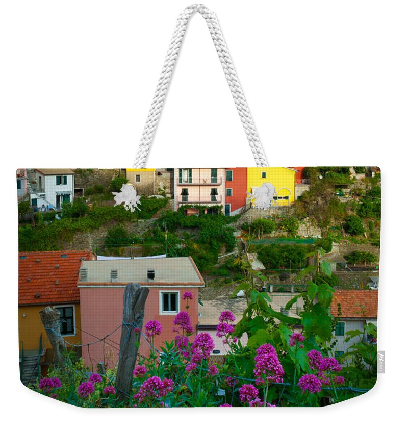 Cinque Terre Weekender Tote Bag featuring the photograph Manarola Flowers And Houses by Inge Johnsson