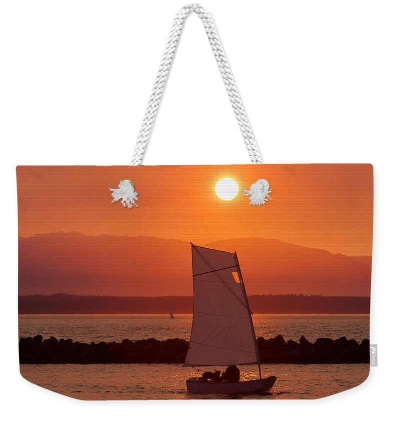 Sunset Weekender Tote Bag featuring the photograph Mans Best Friend by Scott Campbell