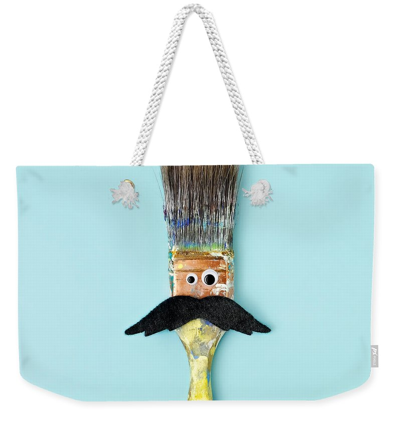 Work Tool Weekender Tote Bag featuring the photograph Mans Face Crafted Onto Paintbrush by Juj Winn