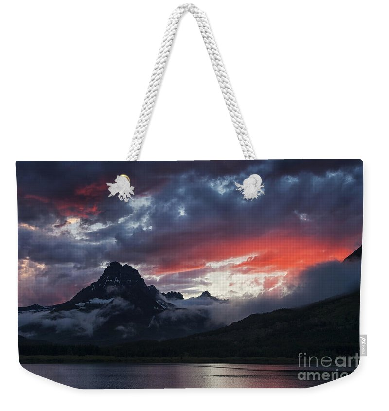 Glacier National Park Weekender Tote Bag featuring the photograph Many Glacier Sunset by Mark Kiver