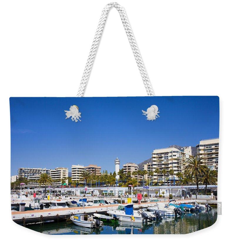 Marbella Weekender Tote Bag featuring the photograph Marbella Marina In Spain by Artur Bogacki