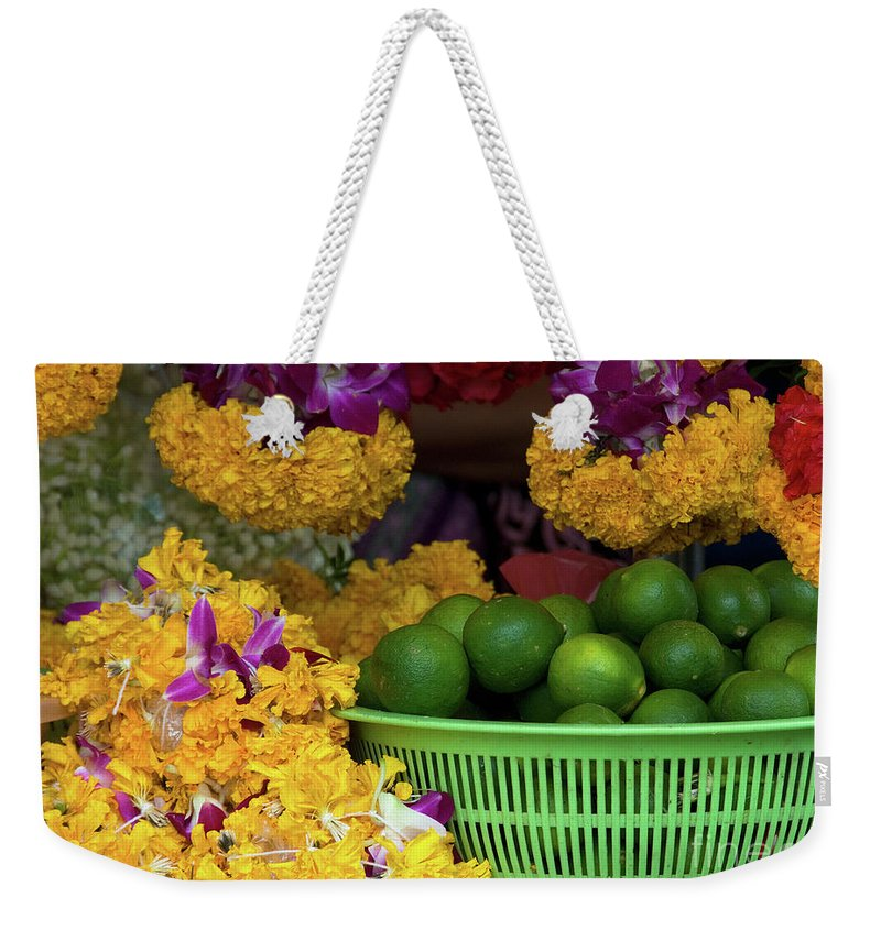 Lime Weekender Tote Bag featuring the photograph Marigolds And Limes by Rick Piper Photography