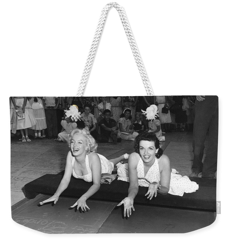 1950's Weekender Tote Bag featuring the photograph Marilyn Monroe And Jane Russell by Underwood Archives