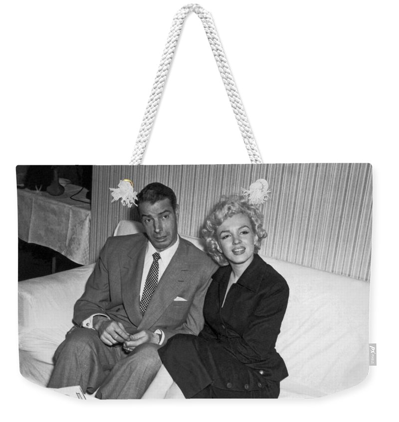 1954 Weekender Tote Bag featuring the photograph Marilyn Monroe And Joe Dimaggio by Underwood Archives
