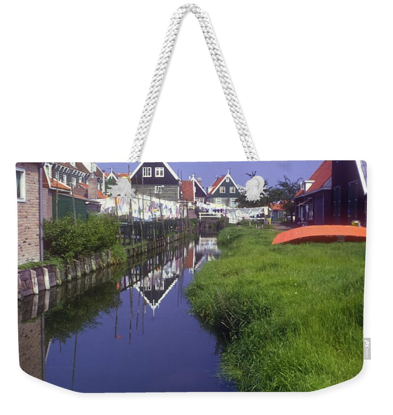 Marken Weekender Tote Bag featuring the photograph Marken Canal by Bob Phillips