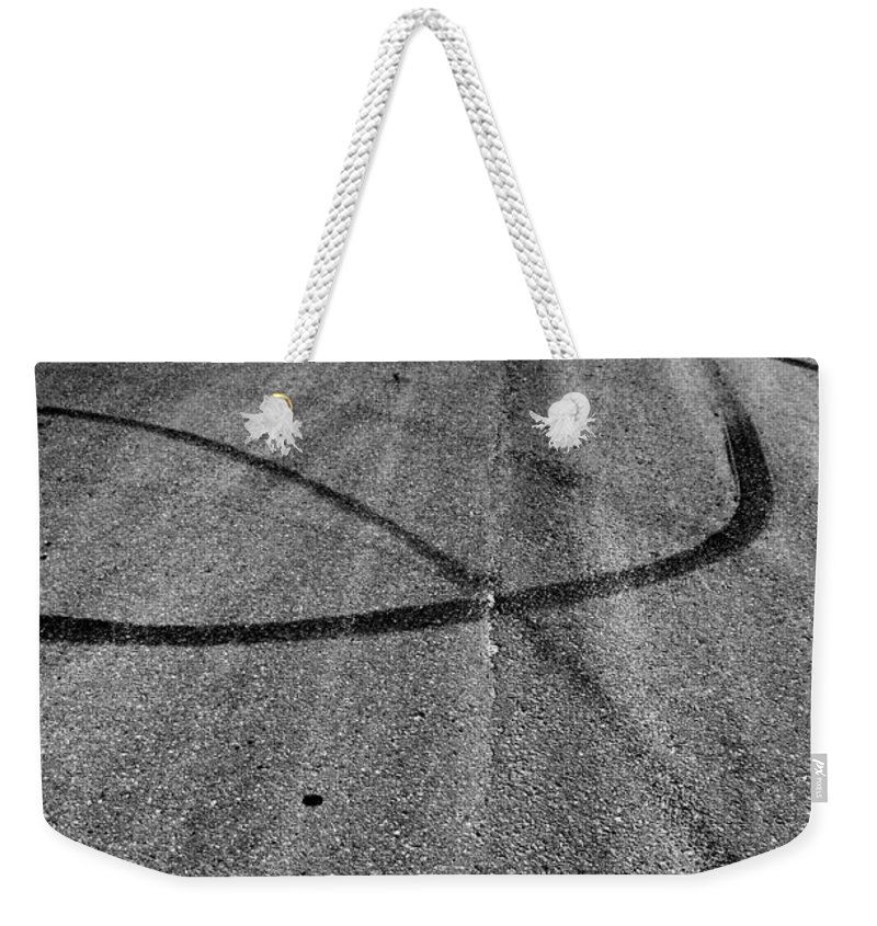 Street Weekender Tote Bag featuring the photograph Marks In Our Road by The Artist Project