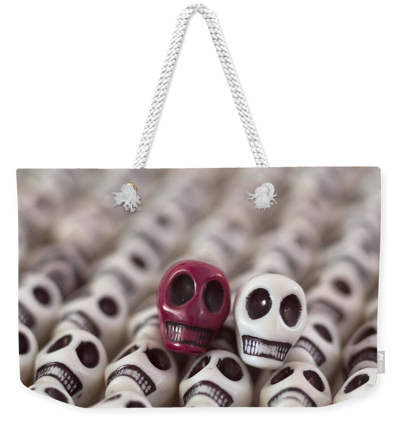 Smiles Weekender Tote Bag featuring the photograph Maroon And White by Mike Herdering