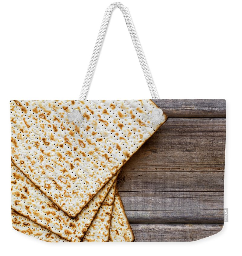 Celebration Weekender Tote Bag featuring the photograph Matza Background by Vlad Fishman