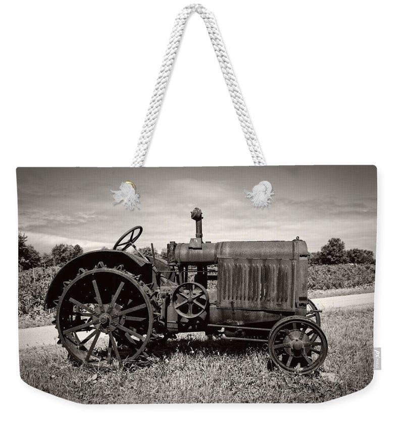 1921 Weekender Tote Bag featuring the photograph Mccormick Deering 15-30 by Debra and Dave Vanderlaan