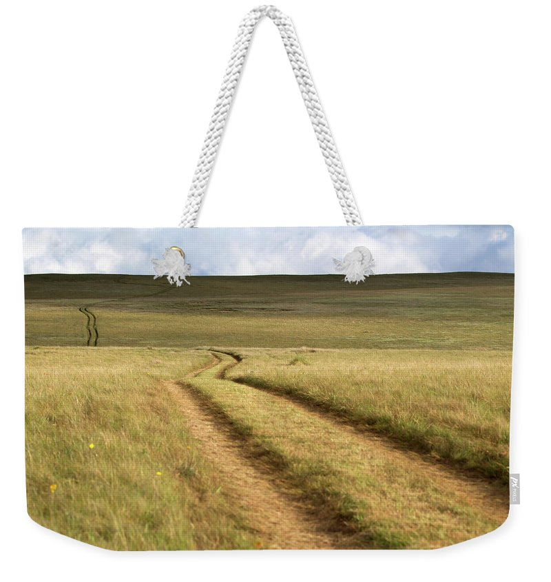 Scenics Weekender Tote Bag featuring the photograph Meandering Path Through The Hills Of by Morgan Trimble