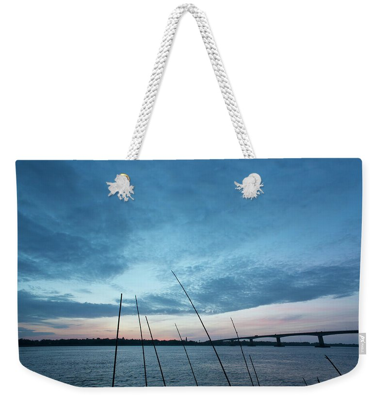 Scenics Weekender Tote Bag featuring the photograph Mekong River At Dawn With Bridge by Eitan Simanor