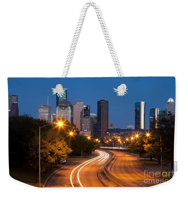 Houston Weekender Tote Bag featuring the photograph Memorial Drive And Houston Skyline by Bill Cobb
