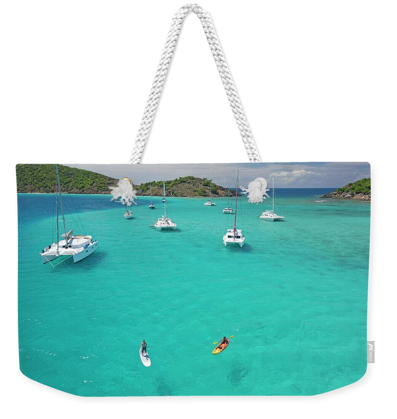 Scenics Weekender Tote Bag featuring the photograph Men Doing Water Activities by Karl Weatherly