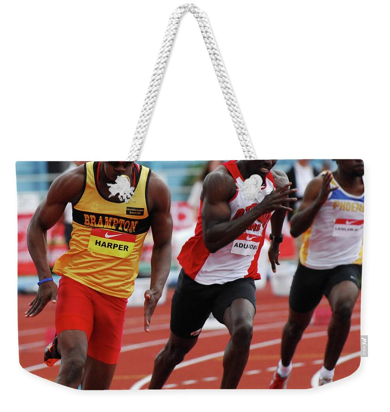 Canadian Track And Field National Championships 2011 Weekender Tote Bag featuring the photograph Mens 200 Meter by Bob Christopher