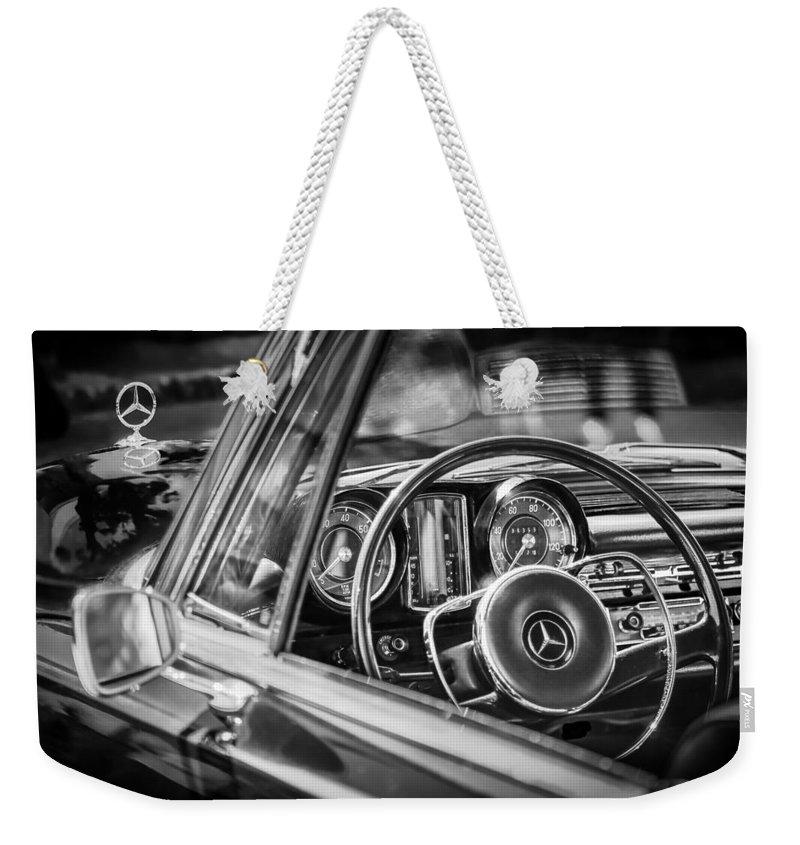 Mercedes-benz 250 Se Steering Wheel Emblem Weekender Tote Bag featuring the photograph Mercedes-benz 250 Se Steering Wheel Emblem by Jill Reger
