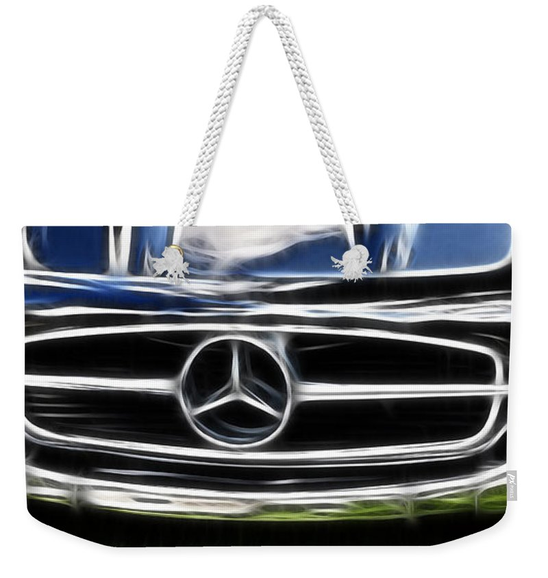 Mercedes Weekender Tote Bag featuring the photograph Mercedes by Wes and Dotty Weber