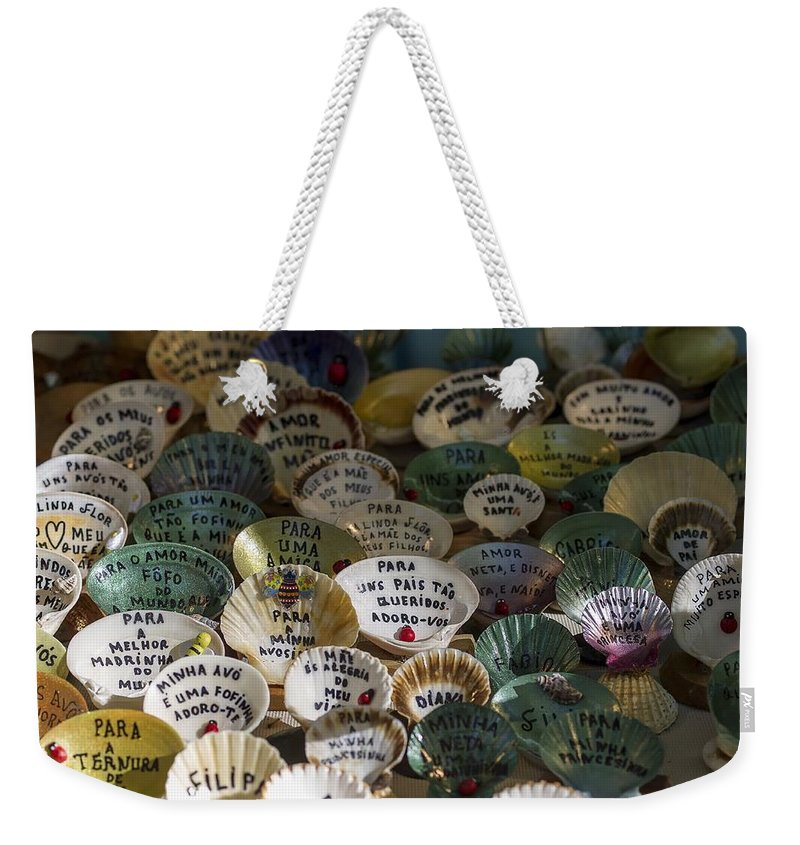 Message Weekender Tote Bag featuring the photograph Messages On Shells by Paulo Goncalves