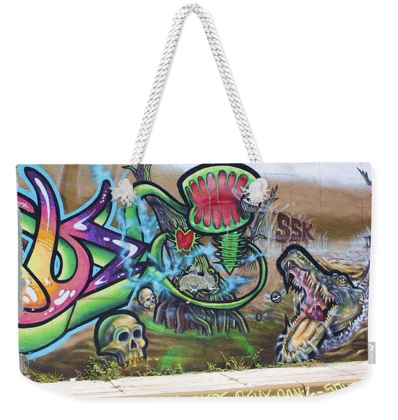 Eyes Weekender Tote Bag featuring the photograph Miami Swamp by Chuck Hicks