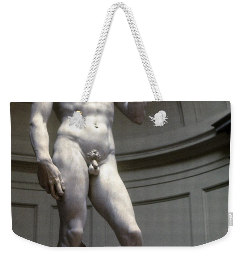 Museum Museums Statue Statues Florence The David Florence Marble Sculpture Sculptures Michelangelo's David Accademia Gallery Masterpiece Artwork Italy Weekender Tote Bag featuring the photograph Michelangelo's David by Bob Phillips