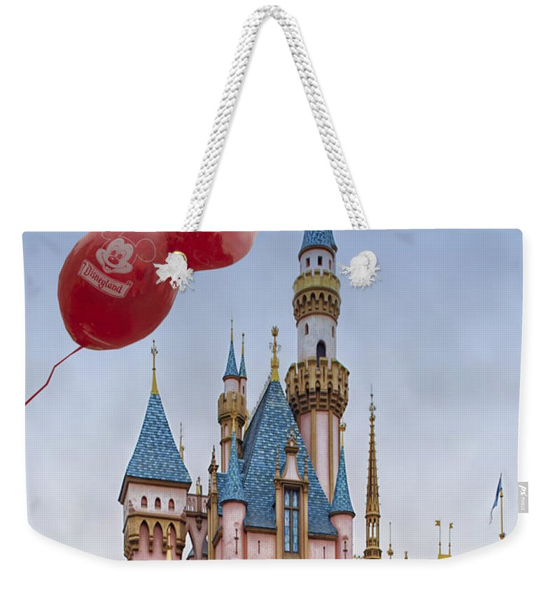 Disney Weekender Tote Bag featuring the photograph Mickey Mouse Balloon At Disneyland by Thomas Woolworth