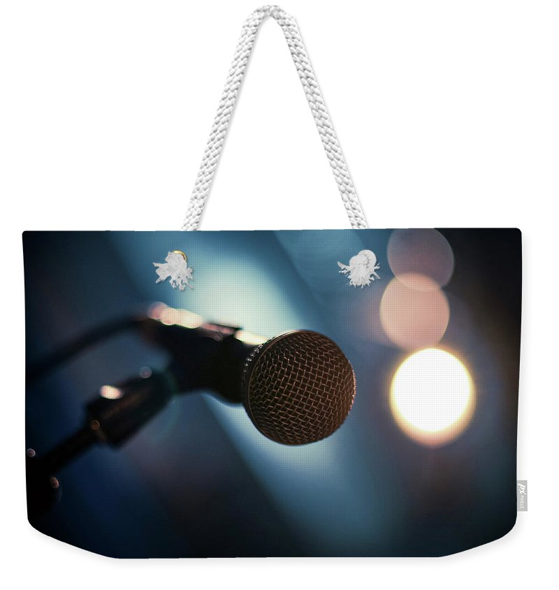 Microphone Stand Weekender Tote Bag featuring the photograph Microphone Abstract Close Up In Concert by Alexandre Moreau