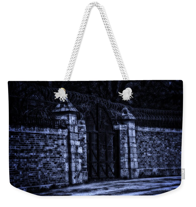 Surrealist Weekender Tote Bag featuring the photograph Midnight At The Prison Gates by Thomas Woolworth